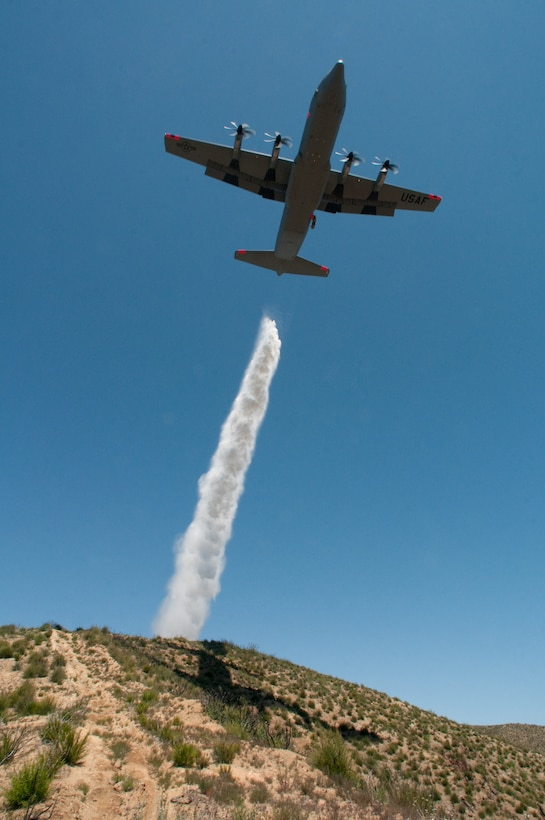 146th Airlift Wing MAFFS-equipped C-130J, California Air National Guard, drops water over the Angeles National Forest May 14, 2013. The 146th Airlift Wing held their annual Modular Airborne Firefighting Systems (MAFFS) recertification and training in partnership with U.S. Forest Service and CAL FIRE to prepare for the upcoming wildfire season. (U.S. Air National Guard photo by Staff Sgt. Nick Carzis)