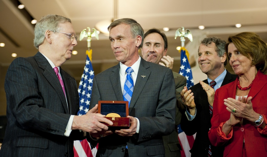 Washington D.C. -- National Museum of the U.S. Air Force Director Lt. Gen. (Ret.) John Hudson accepts the Doolittle Raiders Congressional Gold Medal on behalf of the Raiders on April 15, 2015. (left to right) Senate Majority Leader Mitch McConnell (R-KY), Museum Director Lt. Gen. (Ret.) John Hudson, Representative Pete Olson (R-TX-22nd District), Senator Sherrod Brown (D-OH)  and House Democratic Leader Nancy Pelosi (D-CA). (U.S. Air Force photo)
