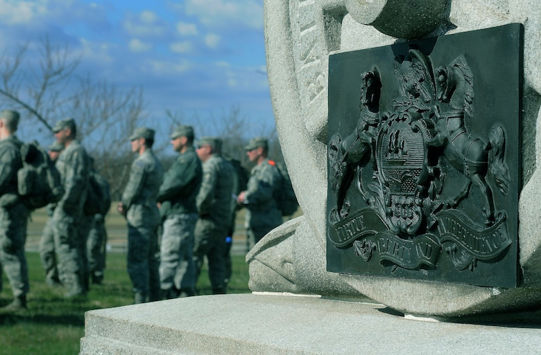 Members of the 111th Security Forces Squadron, Horsham Air Guard Station, Pennsylvania, stop to listen to a speaker during a ruck march at Gettysburg National Military Park, April 11, 2015. Nearly 60 Guardsmen from the 111th Attack Wing's security forces squadron participated in a four-day team building and skills-training event, April 9 – 12, 2015, at the state's joint-force training center at Fort Indiantown Gap and at Gettysburg National Military Park.  (U.S. Air National Guard photo by Tech. Sgt. Andria Allmond/Released)