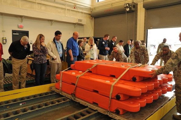 Employers of 403rd Wing reservists are given a mock demonstration of how a C130J is loaded by the 41st Aerial Port Squadron during Employer Appreciation Day April 11, 2015, at Keesler Air Force Base, Mississippi.  Employers were given a tour, demonstrations and participated in a flight on a C130J flown by an 815th Airlift Squadron crew.  (U.S. Air Force photo/Master Sgt. Jessica Kendziorek)