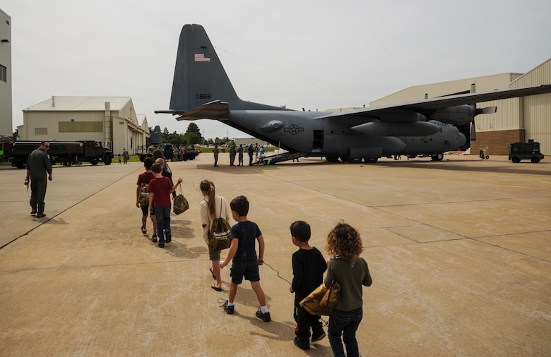 Children march to a C-130H during the Kids Understanding Deployment Operations event April 11, 2015, at Little Rock Air Force Base, Ark. By showing them what their parents do at work and seeing the deployment process, hopefully it will lessen any anxieties they may have about deployments (U.S. Air Force photo by Airman 1st Class Harry Brexel)