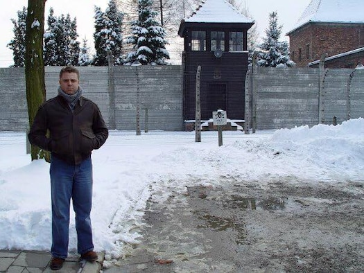 Lt. Col. Glenn Rineheart, 36th Mobility Readiness Squadron commander, stands in front of the site of Nazi Germany's largest and most notorious concentration camp in Aushwitz, Poland, in 2004. (Courtesy photo/Released)