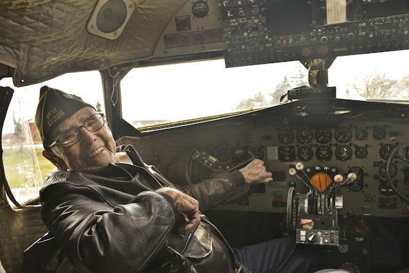 Retired Lt. Col. Alston Daniels beams as he sits in the cockpit of a Douglas C-47D Skytrain for the first time since 1962 April 7, 2015, at Fairchild Air Force Base, Wash. Daniels flew the C-47 during World War II and had the chance to visit the aircraft while it is on static display. (U.S. Air Force photo/Staff Sgt. Alex Montes)