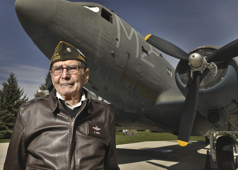 Retired Lt. Col. Alston Daniels stands proudly outside of a Douglas C-47D Skytrain on static display at Fairchild AFB, Wash. April 7, 2015. Daniels flew the C-47 during World War II and calls it his favorite plane of the 10 he flew throughout his career. (U.S. Air Force photo/Staff Sgt. Alex Montes)