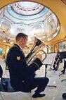 Spc. Thomas Spencer plays with four other brass players from the 1st Inf. Div. Band March 12 at the Kansas State Capitol in Topeka.