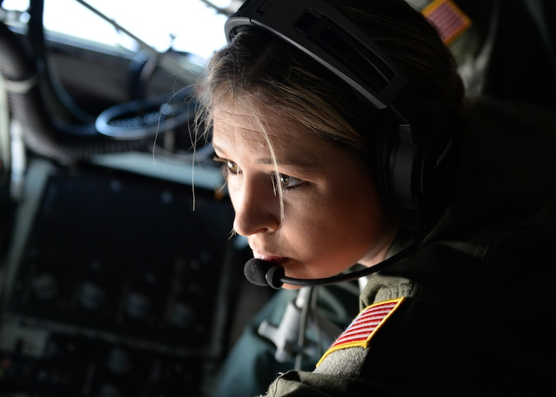 Staff Sgt. Amanda Walls, KC-135 Stratotanker boom operator student, runs through her pre-flight checklist on her final check ride, April 10, 2015. Boom operator students go through a four month course where they are given five flights and a final check ride to determine whether they're ready to be a qualified boom operator. (U.S. Air Force photo/Airman 1st Class Nathan Clark)
