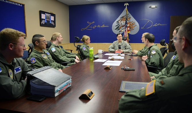 Members of the 10th Missile Squadron meet prior to dispatching to the missile field March 16, 2015, at Malmstrom Air Force Base, Mont. Before each dispatch, missileers meet with each other to discuss any pressing matters. (U.S. Air Force photo/Airman 1st Class Dillon Johnston)