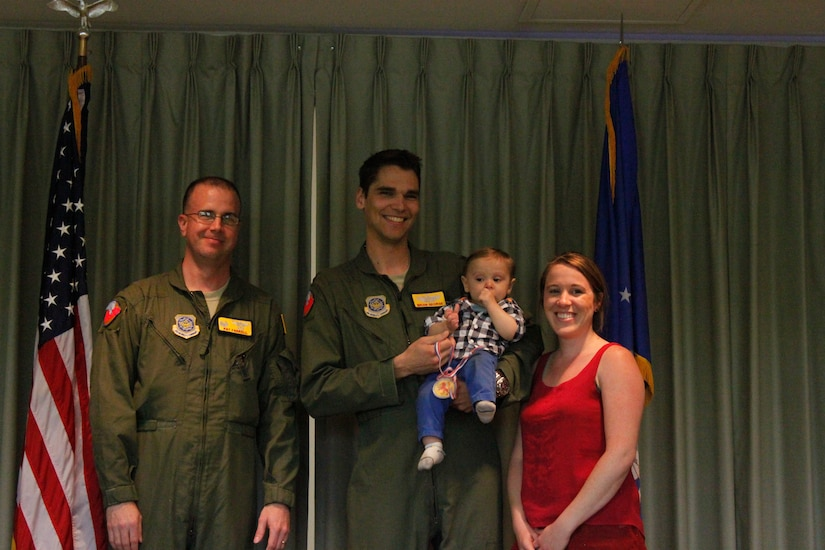Lt. Col. Patrick Farrell, 16th Airlift Squadron commander (left) presented a Medal of Application to Ethan George, one of the squadron's Little Lions during the Little Lions ceremony April 10 2015 in the squadron's auditorium at Joint Base Charleston, S.C. Ethan's parents are Capt. Brian George, 16th AS and Brooke George.   In all, 35 Little Lions were recognized, and no achievement was too small; everything from helping around the house to making the high school honor list was celebrated.  Each child was given a medal and certificate to thank them for their bravery. (Courtesy photo)