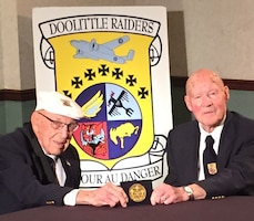 DAYTON, Ohio -- Doolittle Tokyo Raiders Lt. Col. Richard Cole, co-pilot of Crew No. 1, and Staff Sgt. David Thatcher, engineer-gunner of Crew No. 7, see their Congressional Gold Medal for the first time on April 17, 2015. During a ceremony on April 18 at the museum, the medal will be presented to the museum for inclusion in the Doolittle Raid exhibit. (U.S. Air Force photo)