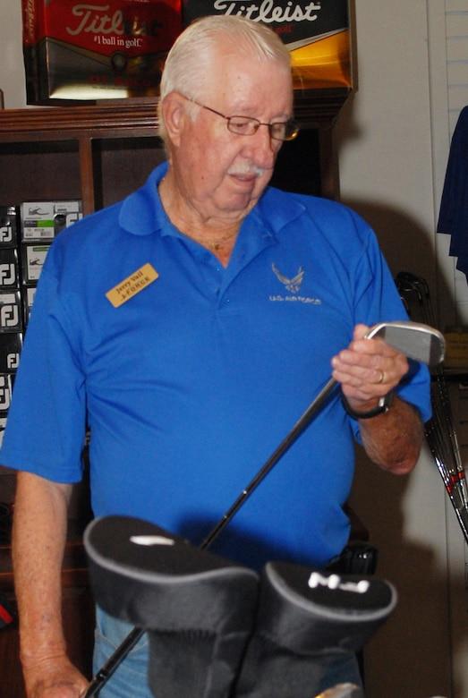 Jerry Vail, Pine Oaks Golf Course pro shop clerk, checks his merchandise. The Pro Shop is open Monday through Sunday from 7 a.m. to 7 p.m. (U.S. Air Force photo by Misuzu Allen)