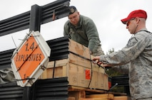 Senior Airman Bryan Korff and Master Sgt. Stephen Houseman unload ammunition crates at Canadian Forces Base Borden, ON, Canada on April 10, 2015. Korff and Houseman were instructing members of the 914th Security Forces Squadron proper weapon employment. (U.S. Air Force photo by Staff Sgt. Matthew Burke)