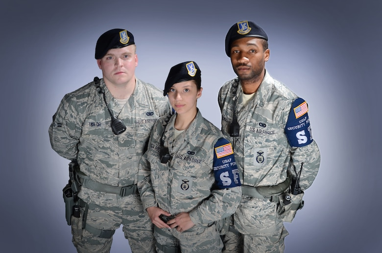 From left, Senior Airman Brenton Taylor, Airman 1st lass Maria Valencia-Ruiz and Senior Airman Derrick Thomas are three of the 22 security forces Airmen serving in the Elite Gate Guard section at Robins. Members must apply for their positions and are chosen based on overall professional customer service and courtesy. (U.S. Air Force photo by Tommie Horton)