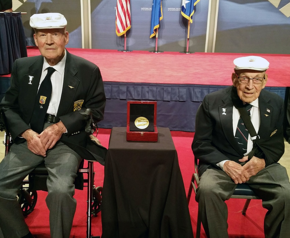 Doolittle Raiders Lt. Col. Richard Cole, co-pilot of Crew No. 1, and Staff Sgt. David Thatcher, engineer-gunner of Crew No. 7, with the Congressional Gold Medal. The medal is on display in the museum's World War II Gallery in the Doolittle Raid exhibit. (U.S. Air Force photo)