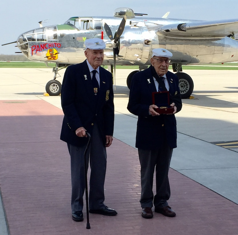 "Doolittle Raiders Lt. Col. Dick Cole and Staff Sgt. David Thatcher pose with the Congressional Gold Medal after it arrived at Wright-Patterson AFB following a ceremonial flight on board the B-25 ""Panchito."" (U.S. Air Force photo)"