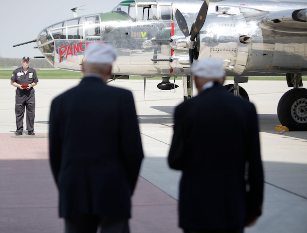 """Doolittle Tokyo Raiders Association Sgt. at Arms Brian Anderson prepares to hand the Congressional Gold Medal to Doolittle Raiders Lt. Col. Dick Cole and Staff Sgt. David Thatcher after a ceremonial flight on board the B-25 """"Panchito."""" (U.S. Air Force photo by Will Haas)"""
