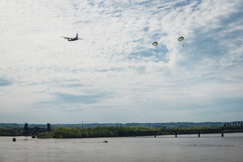 A Kentucky Air National Guard C-130 Hercules aircraft deploys two bundles of simulated candy over the Ohio River during the Thunder Over Louisville air show in Louisville, Ky., April 18, 2015. The drop was a tribute to Col. Gail Halvorsen, a retired C-54 pilot who originated the idea of air-dropping candy to German children during the Berlin Airlift of 1948-49. Halvorsen was guest of honor at this year's show. (U.S. Air National Guard photo by Maj. Dale Greer)