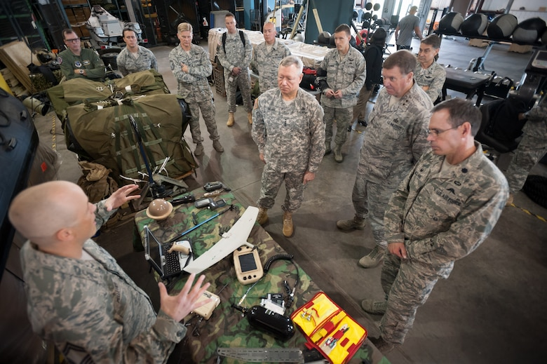 Army Gen. Frank J. Grass, chief of the National Guard Bureau, receives a mission brief from members of the 123rd Special Tactics Squadron during a tour of the Kentucky Air National Guard Base in Louisville, Ky., April 18, 2015. The 123rd is the only special tactics unit in the Air National Guard with both combat controllers and pararescuemen. (U.S. Air National Guard photo by Maj. Dale Greer)