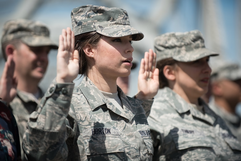 Senior Airman Lindsey Horton, a recruiting assistant in the Kentucky Air National Guard, takes the oath of enlistment during a mass swearing-in ceremony on the Clark Memorial Bridge in downtown Louisville, Ky., April 18, 2015. The ceremony, which kicked off the Thunder Over Louisville air show, was led by Army Gen. Frank J. Grass, chief of the National Guard Bureau. (U.S. Air National Guard photo by Maj. Dale Greer)