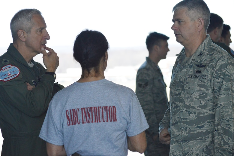 Lt. Col. Alan Ross, 109th Airlift Wing vice commander (left), and Col. Shawn Clouthier, 109th AW commander, talk with Master Sgt. Candace Stefanik, 109th AW self-aid buddy care adviser, during the hands-on SABC portion of the 109th Airlift Wing's first ancillary training rodeo April 18, 2015. More than 200 Airmen went through the training which also included chemical, biological, radiological and nuclear training. (U.S. Air National Guard photo by Tech. Sgt. Catharine Schmidt/Released)