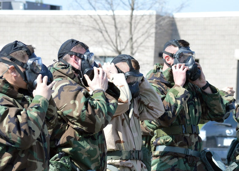 Airmen don their masks during the hands-on chemical, biological, radiological and nuclear training at Stratton Air National Guard Base, New York, on April 18, 2015. The training was part of the 109th Airlift Wing's first ancillary training rodeo where more than 200 Airmen were trained on CBRN as well as self-aid and buddy care. (U.S. Air National Guard photo by Tech. Sgt. Catharine Schmidt/Released)