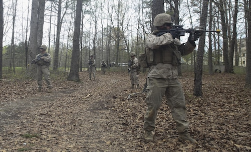 Marines with Light Armored Reconnaissance, Battalion Landing Team 2/6, 26th Marine Expeditionary Unit, patrol an Improvised Explosive Device lane during Realistic Urban Training aboard Fort Pickett, Va., April 15, 2015. IED lanes are used to teach Marines what to expect when looking for a device, how to react once one is spotted and once one is detonated. During this exercise, Marines were tasked with finding one device and reacting to one being triggered at an unknown time. (Official U.S. Marine Corps photo by Lance Cpl. Dalton A. Precht)