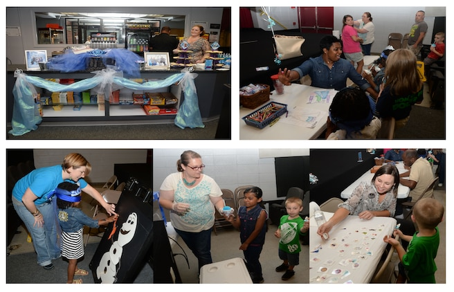 """Marine Corps Logistics Base Albany personnel celebrate the installation's military children with crafts, games and a movie at the Base Theater, April 14. Participants were greeted at the door and invited into a lace-decorated entrance and tables filled with """"Frozen"""" character games, crafts, tattoos and assorted ring candies. At the end of the activities, the hit movie """"Frozen"""" was the featured event of the evening. The overall activity was in continuation of the installation's celebration of the Month of the Military Child, which is held annually in April."""