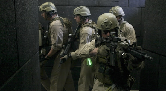 U.S. Marines with Maritime Raid Force, 26th Marine Expeditionary Unit, conduct live-fire room clearing drills at a shoot house aboard Fort Pickett, Va., April 11, 2015. The 26th MEU is conducting realistic urban training in preparation for deployment in the 5th and 6th Fleet areas of responsibility later this year. (U.S. Marine Corps photo by Staff Sgt. Bobby J. Yarbrough/Released)
