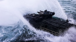 An amphibious assault vehicle belonging to 3rd Platoon, Alpha Company, 2nd Assault Amphibian Battalion splashes into the Atlantic Ocean from the well-deck of the multipurpose amphibious assault ship USS Kearsarge (LHD-3) April 13, 2015. The platoon used their amphibious assault vehicles to transport Marines from 1st Battalion, 6th Marine Regiment in support of a ship-to-shore exercise off the coast of Onslow Beach, Camp Lejeune, N.C.