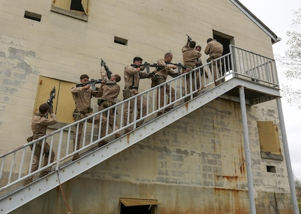 U.S. Marines with Maritime Raid Force, 26th Marine Expeditionary Unit, conduct drills to clear a building during an urban assault course at Fort Pickett, Va., April 14, 2015. The 26th MEU and its supporting elements are conducting realistic urban training in preparation for deployment to the 5th and 6th Fleet areas of responsibility later this year. (U.S. Marine Corps photo by Cpl. Joshua W. Brown/Released)
