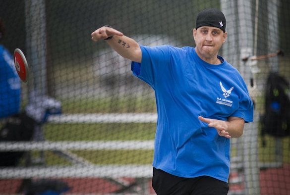 Senior Airman Chris Fugitt, a retired 96th Aircraft Maintenance Squadron Airman and an Air Force wounded warrior athlete, lets the discus fly at the track during the second day of an introductory adaptive sports and rehabilitation camp at Eglin Air Force Base, Fla., April 14, 2015. Two years after complications from a massive stroke forced Fugitt to retire from the Air Force, his warrior spirit enabled him to power past a number of debilitating setbacks and attend his first camp. (U.S. Air Force photo/Samuel King Jr.)