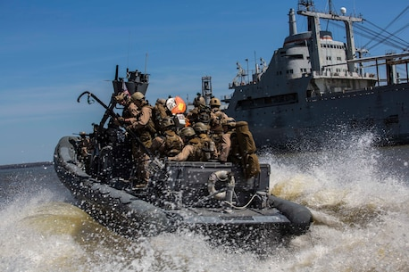 U.S. Marines assigned to Force Reconnaissance Platoon, Maritime Raid Force, 26th Marine Expeditionary Unit (MEU) prepare to board a ship from Rigid-Hull Inflatable Boats during Visit, Board, Search, and Seizure (VBSS) training at Joint Base Langley-Eustis, VA, April 12, 2015. The Marines were evaluated on their training as part of their preparation for deployment to the 5th and 6th Fleet Areas of responsibility later this year. (U.S. Marine Corps photo by Lance Cpl. Andre Dakis/26th MEU Combat Camera/Released)