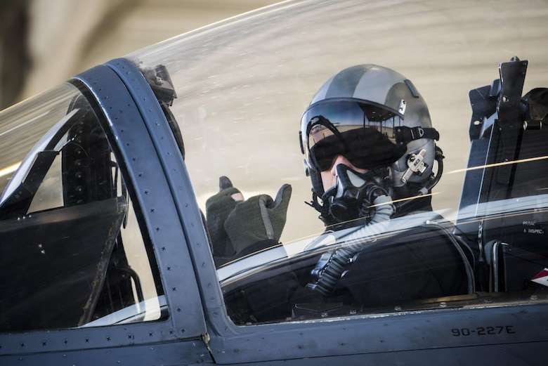 A pilot assigned to the 391st Fighter Squadron signals a crew chief to pull chocks during an exercise at Mountain Home Air Force Base, Idaho, April 13, 2015. The joint service Gunfighter Flag 15-2 exercise provided aircrew with valuable training opportunities to keep them ready to fight. (U.S. Air Force photo/Airman Connor J. Marth)