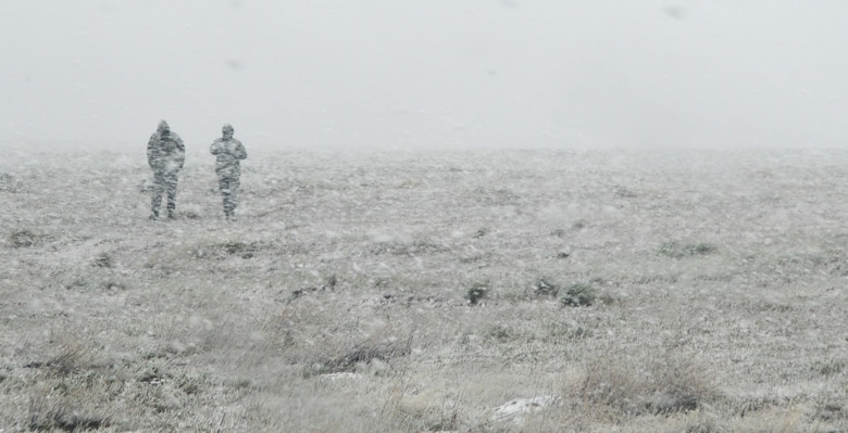 Airmen walk through a snowstorm during Gunfighter Flag 15-2 at Saylor Creek Range, Idaho, April 14, 2015. The unexpected whiteout conditions temporarily shut down the exercises scheduled that day. (U.S. Air Force photo/Senior Airman Lauren-Taylor Levin)