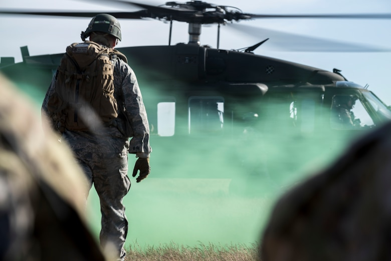 Capt. Ryan Kiggins, a 366th Security Forces Squadron operations officer, approaches an Army UH-60 Blackhawk during Gunfighter Flag 15-2 at Saylor Creek Range, Idaho, April 15, 2015. Kiggins led members of the 366th SFS through a variety of scenarios to better prepare them for deploying to hostile locations. (U.S. Air Force photo/Airman 1st Class Jeremy L. Mosier)