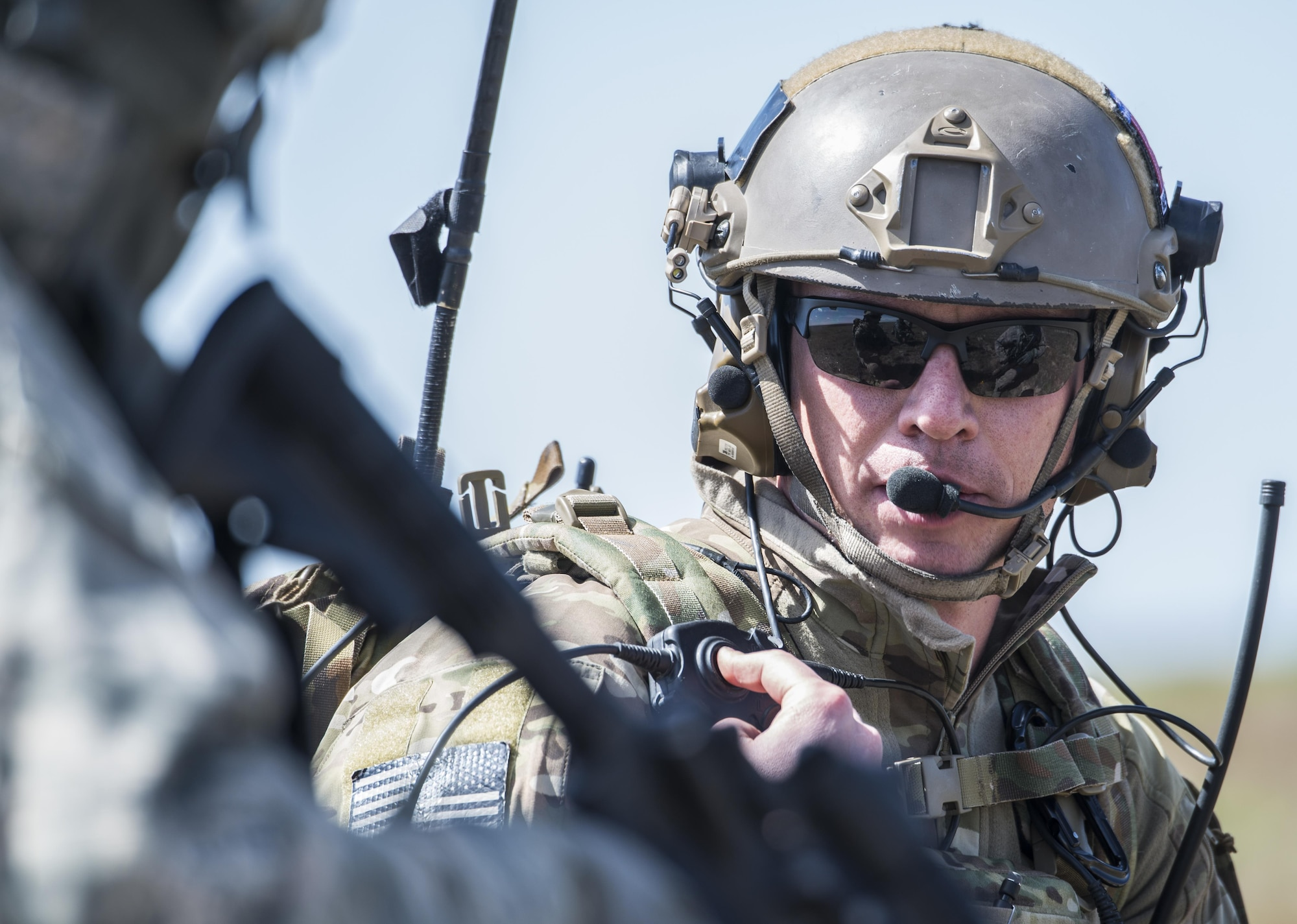 Master Sgt. Mark Andrews, 124th Air Support Operation Squadron tactical air control party, calls in close air support during Gunfighter Flag 15-2 at Saylor Creek Range, Idaho, April 15, 2015. The exercise consisted of realistic tactical scenarios to train joint service members for deployed missions. (U.S. Air Force photo/Staff Sgt. Roy Lynch III)