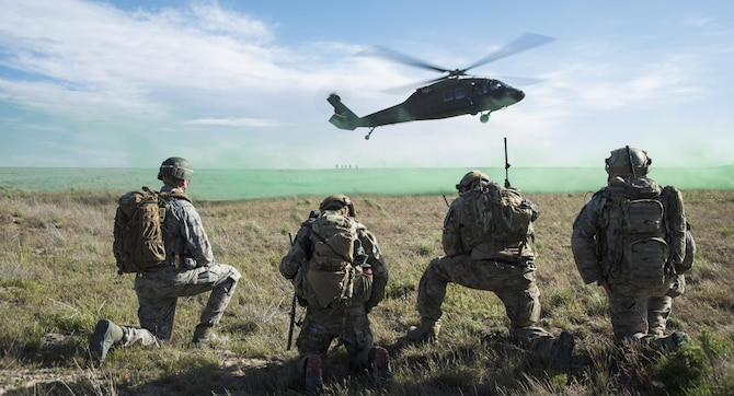 An Army UH-60 Blackhawk lands to pick up 366th Security Forces Squadron and 124th Air Support Operation Squadron members during Gunfighter Flag 15-2 at Saylor Creek Range, Idaho, April 15, 2015. The exercise allowed joint service members a chance to execute realistic operation scenarios in an environment similar to Southwest Asia. (U.S. Air Force photo/Staff Sgt. Roy Lynch III)