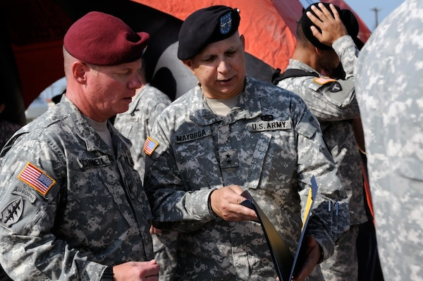 Lt. Col. Douglas of O'Connell, commander of 1st Battalion of the 143rd Infantry Regiment (Airborne), talks with Maj. Gen. Jose S. Mayorga, the adjutant general of the Texas National Guard, after the reactivation ceremony of the 1st Battalion of the 143rd Infantry Regiment (Airborne) at the Texas State Technical College airport in Waco, Texas, Sept. 11, 2010.