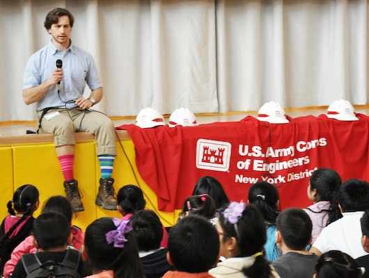 Ian Pumo, civil engineer, U.S. Army Corps of Engineers, New York District interacts with students at a NYC public school and speaks about the importance of STEM.
