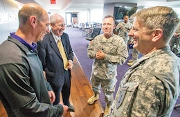 (From left) Sean Snyder, K-State football associate head coach, special teams coordinator and director of football operations, and his father, Bill Snyder, K-State football head coach, talk with Lt. Col. James D. Lander and Command Sgt. Maj. Todd R. Nibarger, the command team of the 1st Bn., 28th Inf. Regt., 4th IBCT, 1st Inf. Div., March 25 at Bill Snyder Family Stadium in Manhattan, Kansas.