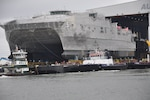 The future Military Sealift Command joint high-speed vessel USNS Trenton (JHSV 5) rolls out in preparation for launch at Austal USA shipyard.