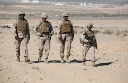 From left to right, Sergeant Major of the Marine Corps Ronald L. Green walks alongside 1st Sgt. John D. Dober, company first sergeant, Company A; Sgt. Maj. Robin C. Fortner, sergeant major; and 1st Sgt. Rena M. Bruno, company first sergeant, Weapons Company, all with the Ground Combat Element Integrated Task Force, during a visit to Range 107, Marine Corps Air Ground Combat Center Twentynine Palms, California, April 18, 2015. From October 2014 to July 2015, the GCEITF will conduct individual and collective level skills training in designated ground combat arms occupational specialties in order to facilitate the standards-based assessment of the physical performance of Marines in a simulated operating environment performing specific ground combat arms tasks. (U.S. Marine Corps photo by Cpl. Paul S. Martinez/Released)