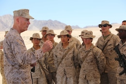 Commandant of the Marine Corps Gen. Joseph F. Dunford Jr., left, addresses Marines with the Ground Combat Element Integrated Task Force during a visit to Range 107, Marine Corps Air Ground Combat Center Twentynine Palms, California, April 18, 2015. From October 2014 to July 2015, the GCEITF will conduct individual and collective level skills training in designated ground combat arms occupational specialties in order to facilitate the standards-based assessment of the physical performance of Marines in a simulated operating environment performing specific ground combat arms tasks. (U.S. Marine Corps photo by Cpl. Paul S. Martinez/Released)
