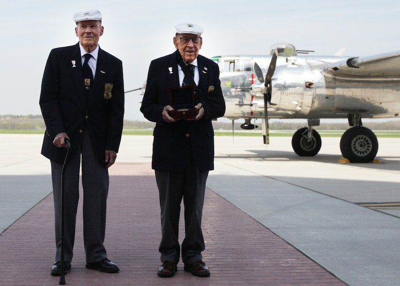 "Doolittle Raiders retired Lt. Col. Dick Cole and former Staff Sgt. David Thatcher pose with the Congressional Gold Medal after it arrived at Wright-Patterson Air Force Base, Ohio, following a ceremonial flight on board the B-25 ""Panchito"" April 18, 2015. The medal is on display in the museum's World War II Gallery in the Doolittle Raid exhibit. (U.S. Air Force photo/Will Haas)"