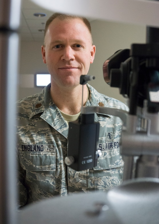 Maj. Craig England, 90th Medical Operations Squadron optometrist, poses for a portrait in his office at the F.E. Warren Medical Treatment Facility, Wyo., April 16, 2015. England is the officer-in-charge of the optometry element. (U.S. Air Force photo by Lan Kim)