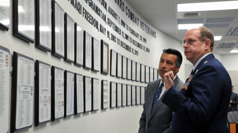 Nevada Gov. Brian Sandoval, left, and Nevada National Guard Adjutant General Brig. Gen. Bill Burks, read the names and units of Nevada Guardsmen who have deployed to combat operations since the Gulf War.  Photo by Nevada Historian Tech. Sgt. Emerson Marcus (RELEASED).