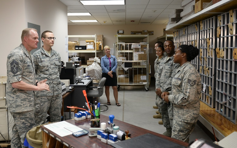 Chief Master Sgt. of the Air Force James A. Cody discusses the future of the postal career field with Staff Sgt. Brittany Smith, a postal clerk April 14, 2015, at Joint Task Force - Bravo, Soto Cano Air Base, Honduras. The post office at Soto Cano Air Base receives mail for approximately 1,200 military members and civilians at Soto Cano. (U.S. Air Force photo by Staff Sgt. Jessica Condit)