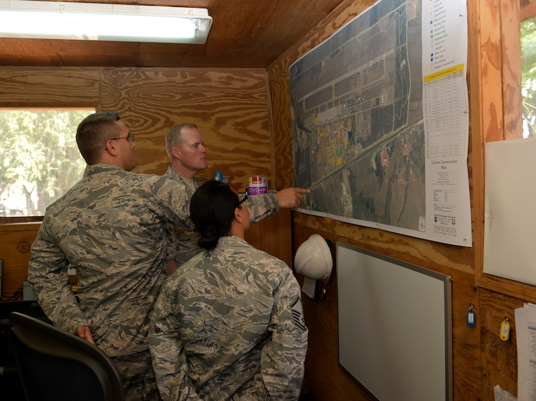 Chief Master Sgt. of the Air Force James A. Cody views future base project plans at the base civil engineer unit April 14, 2015, at Joint Task Force - Bravo, Soto Cano Air Base, Honduras. During his visit, Cody visited BCE as well as several other units throughout Soto Cano AB. (U.S. Air Force photo by Staff Sgt. Jessica Condit)