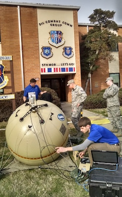 Representatives demonstrate A GATR inflatable satellite communications antenna terminal to members from the 5th Combat Communications Group at Robins Air Force Base, Georgia. (Air Force photo)