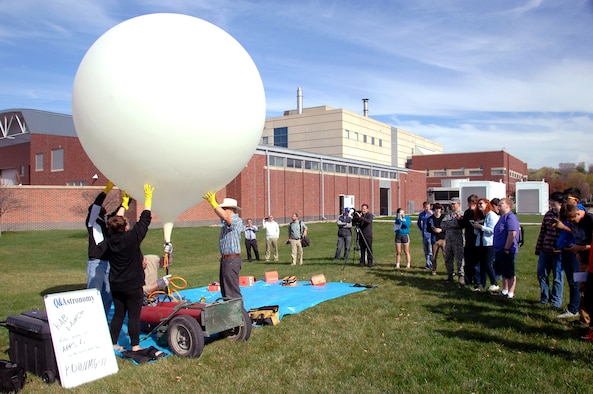Project HALON, or High Altitude Learning over Nebraska, participants prepare a weather balloon for launch outside of the Peter Kiewit Institute at the University of Nebraska at Omaha campus April 14, 2015. The weather balloon will carry five sensor packages up to an altitude of 80-100 thousand feet, collecting meteorological data along the way. (U.S. Air Force photo by Delanie Stafford/Released)