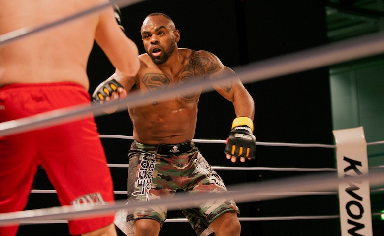 U.S. Air Force Tech. Sgt. Clinton Williams, 52nd Component Maintenance Squadron engine manager, faces off against his opponent, Raymond Jarman, a mixed martial artist from Amsterdam, during the 12th Kwon Respect Fighting Championship in Wuppertal, Germany, April 11, 2015. Williams knocked Jarman out 40 seconds into the first round of their five-round fight. (U.S. Air Force photo by Airman 1st Class Timothy Kim/Released)